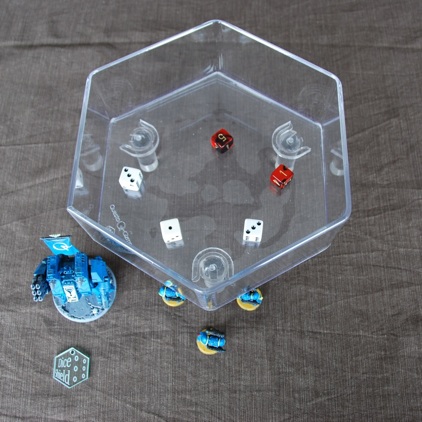 one Dice Shields over miniatures on a table, showing the locking mechanism from the top.
